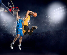 Two Basketball Players In Arena. Blocked Shot
