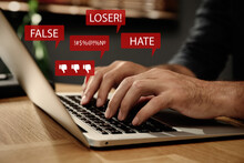 Man Using Laptop And Icons With Offensive Messages, Closeup. Cyber Bulling Concept