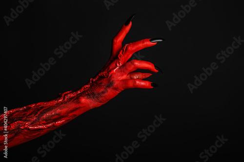 Obraz na płótnie Scary monster on black background, closeup of hand