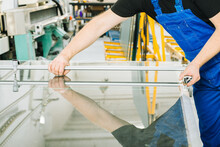 The Glazier Cuts The Glass Panel With A Professional Tool