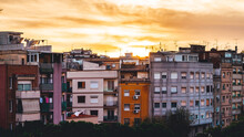 The Sun Dominates A Traditional Neighborhood In Barcelona. The Warm Colors Give A Welcoming Effect.