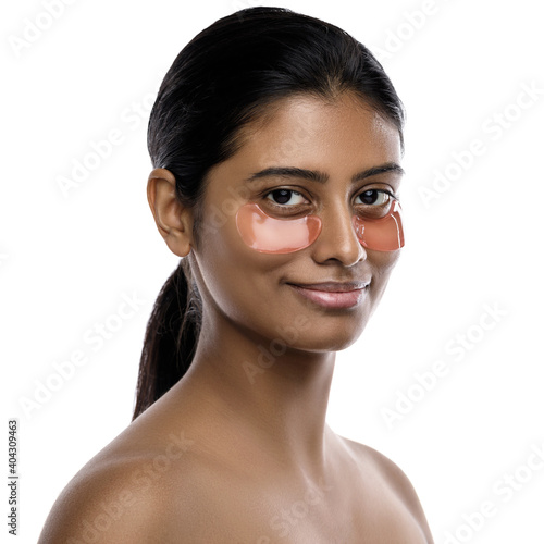 Beautiful Indian woman with hydrating eye patches under her eyes Fototapet