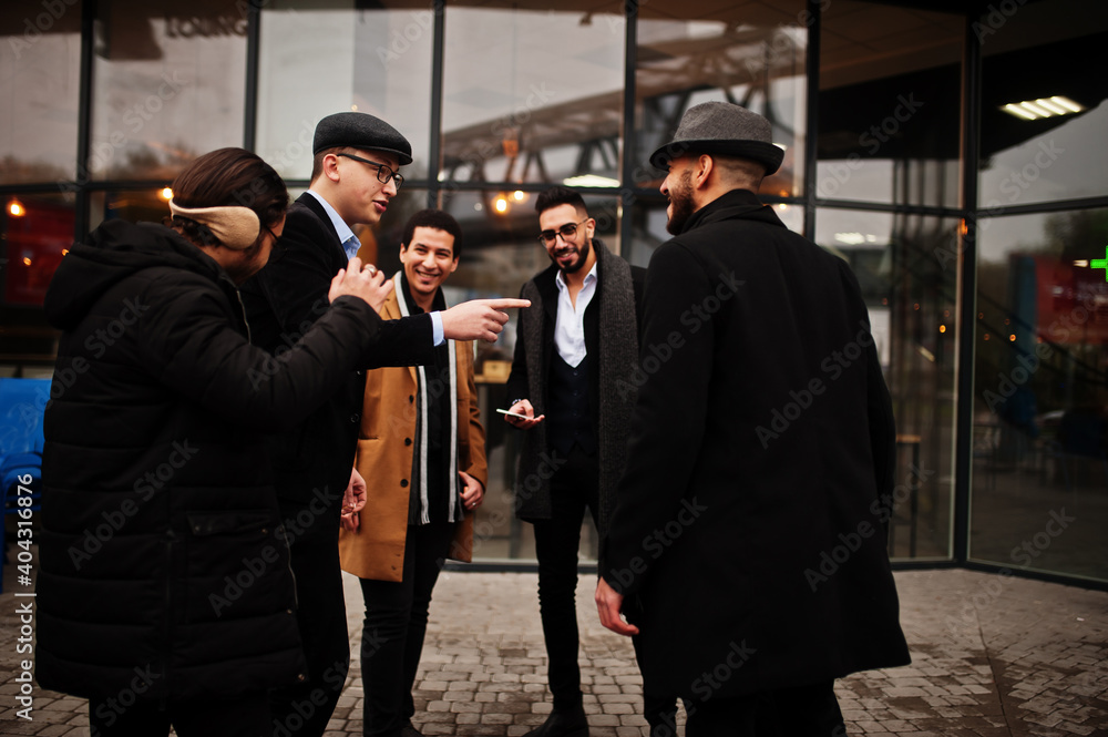 Fototapeta Group of handsome retro well-dressed man gangsters smoking outdoor. Multiethnic male bachelor mafia party.