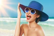 Beautiful Woman Wearing Blue Hat And Sunglasses Enjoying Beach Vacation