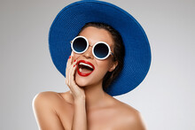 Beautiful Woman Wearing Blue Hat And Sunglasses Is Ready For Vacation