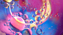 Space Abstract Macro Background Of Oil Mixed With Water On Colorful Gradient