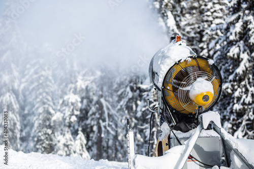 Fotografering Snow cannon gun or machine sprays water and snowes a ski or cross-country track