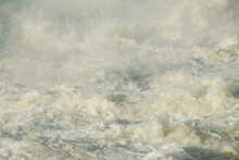 Rough River With Seething Water With Foam And Flying Splashes And Water Drops