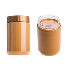Close-up Of Peanut Butter Jars Against White Background