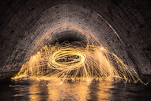 Light Painting In Water Filled Tunnel