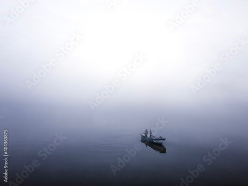 Fototapeta High Angle View Of Rowboat In Sea Against Sky