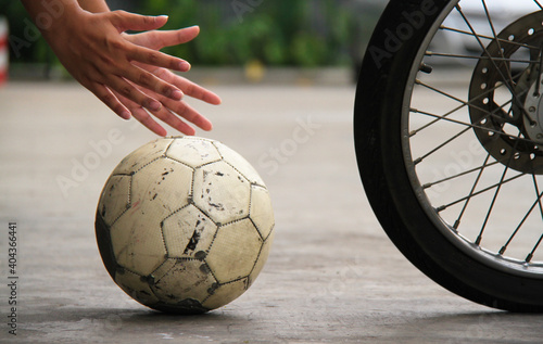 Cropped Hands Holding Soccer Ball On Road