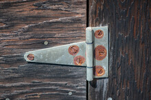 Rusty Hinge On Weathered Wood