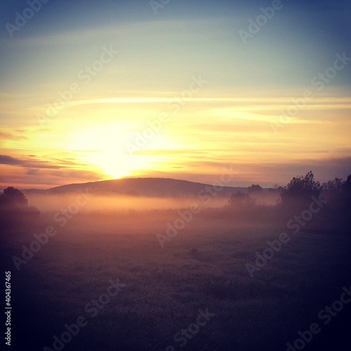 Obraz Scenic View Of Field Against Sky During Sunset - fototapety do salonu