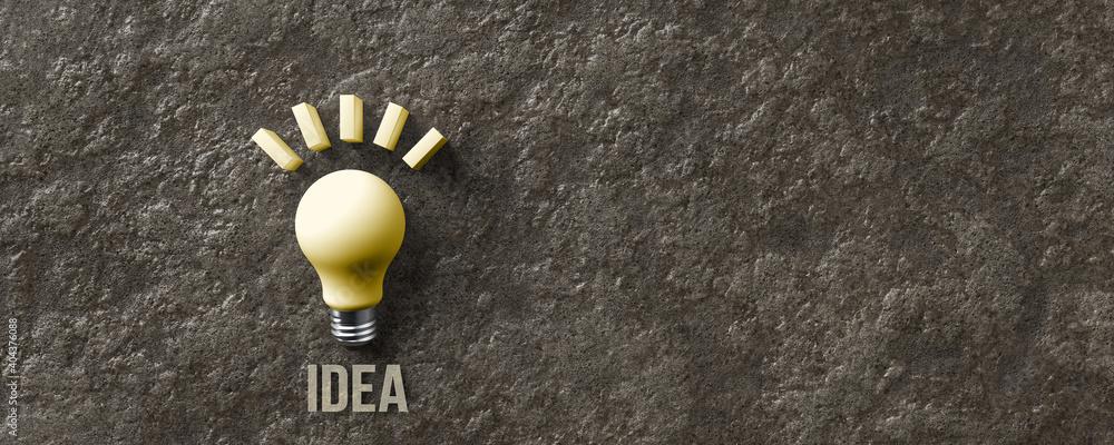 Obraz message IDEA and a lightbulb symbol on stone background fototapeta, plakat