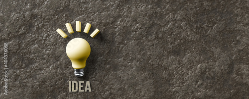 Fototapeta message IDEA and a lightbulb symbol on stone background obraz