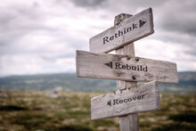 Rethink Rebuild Recover Signpost Outdoors In Nature
