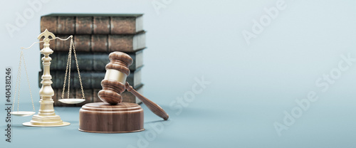Photo Close-up Of Wooden Gavel By Weight Scale And Books Against Blue Background
