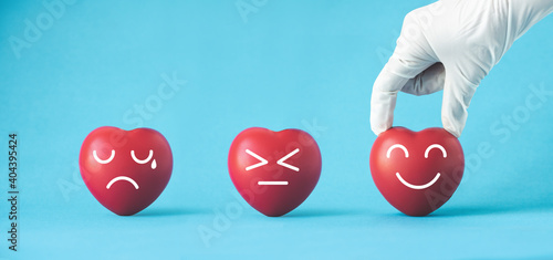 Obraz Doctor hands with medical gloves holding red heart, heart health,saving life. - fototapety do salonu