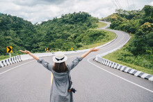 Asian Tourist Raised Her Hands While Looking To Beautiful Steep Curved Road (look Like Number 3) On The High Mountain In Nan Province, Thailand.