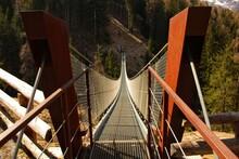 Empty Footbridge Hanging In Forest