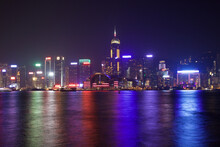 Victoria Harbor Skyline And Two International Finance Center  At Night In Hong Kong