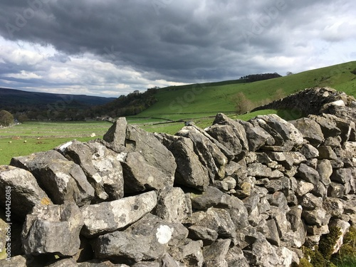 Valokuva Rocks On Field Against Sky