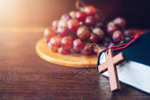 Image Of A Cup Of Grape Juice With Red Grape, Bread, The Wooden Cross Over The Holy Bile With A Grape On Wooden Tray Background, Communion Concept, Easter Background