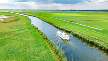 Aerial Drone View Of Houseboat In Canal And Country Landscape Of Holland From Above, Family Travel By Barge Boat And Vacation In Netherlands