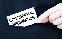 The Businessman Puts The Card In His Pocket With The Text Of Confidential Information.