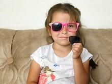 Portrait Of Girl Wearing Broken Sunglasses