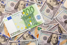 Hundred Euro Bank Note On American Hundred Dollars Finance Background.