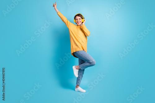Obraz Full length body size side profile photo of woman listening music enjoying wearing headphones dance isolated on vivid blue color background - fototapety do salonu