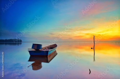 Canvastavla Boat Moored On Sea Against Sky During Sunset