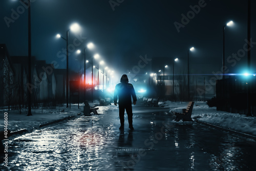 Fotografia Man silhouette in misty alley at night city park, mystery and horror foggy cityscape atmosphere, alone stalker or crime person