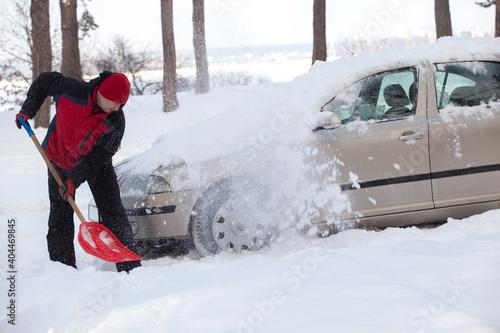 shoveling snow from car, man shoveling snow