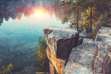 Mountain Lake With A Rocky Shore At Sunrise. Canyon In Autumn
