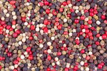 Mixture Of Dry Round Hot Red Pepper, Black Pepper, White Pepper, Green Pepper, Background