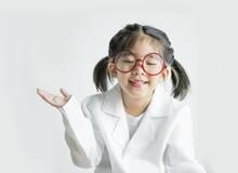 Girl Wearing Eyeglasses Against White Background