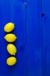 Leinwandbild Motiv High Angle View Of Lemons On Blue Wooden Table