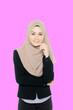 Leinwandbild Motiv Portrait Of Smiling Young Woman Wearing Hijab While Standing Against Purple Background