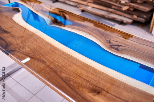 Obraz Texture of a wooden table with epoxy resin. - fototapety do salonu