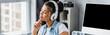 smiling, dreamy african american freelancer listening music in wireless headphones near monitor, banner