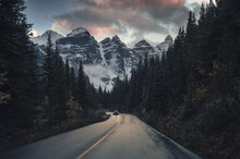Road Trip With Rocky Mountains In Pine Forest Near Moraine Lake At Banff National Park