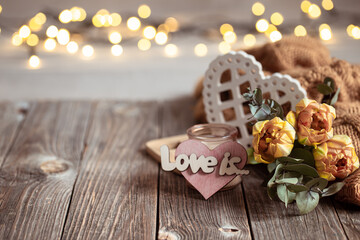 Cozy composition for Valentine's Day with decor details and flowers copy space.