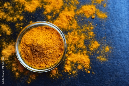 High Angle View Of Turmeric Powder In Bowl On Table