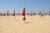 Folded Beach Umbrellas Against Clear Sky
