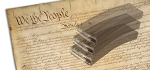3D Illustration With The Public Domain Image Of The United States Constitution With AR-15 Magazines Ghosted On Top