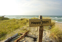 Happy 2021 Wooden Sign In Dune Landscape With The Sea