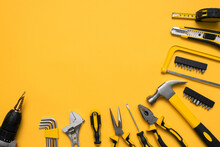 Construction Tools On The Yellow Flat Lay Background With Copy Space.